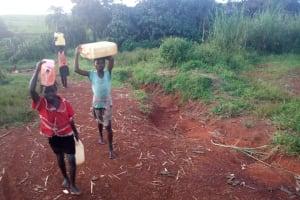 The Water Project: Rubona Kyawendera Community -  Carrying Water