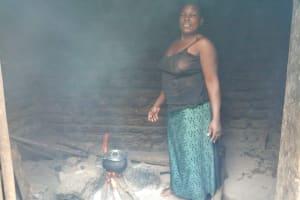The Water Project: Rubona Kyawendera Community -  Cooking In Kitchen