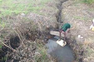 The Water Project: Rubona Kyawendera Community -  Fetching Water At The Open Source