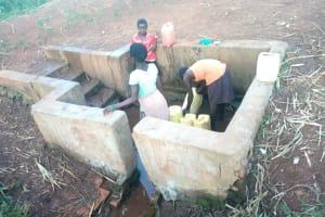 The Water Project: Rubona Kyawendera Community -  Fetching Water At The Spring