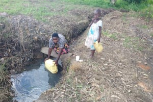 The Water Project: Rubona Kyawendera Community -  Filling Container With Water