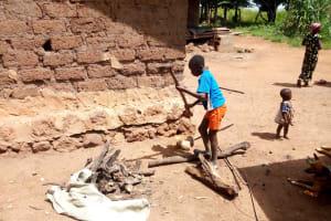 The Water Project: Rubona Kyawendera Community -  Splitting Firewood