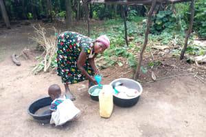 The Water Project: Rubona Kyawendera Community -  Washing Dishes