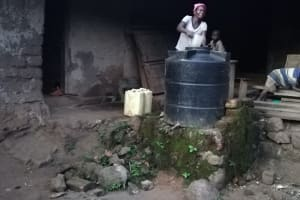 The Water Project: Rubona Kyawendera Community -  Water Storage Container At Home