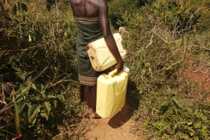 The Water Project: Ejinga Taosati Community -  Carrying Containers To Fill With Water