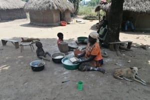 The Water Project: Ejinga Taosati Community -  Preparing Casava