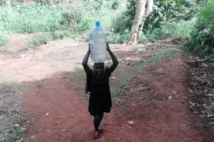 The Water Project: Kabo Village -  Carrying Water