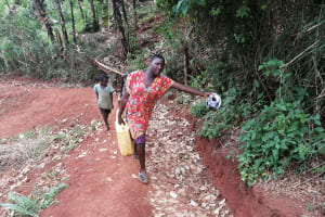 The Water Project: Kabo Village -  Carrying Water Home