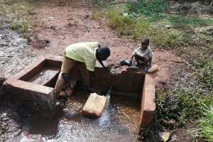The Water Project: Kabo Village -  Fetching Water At The Spring
