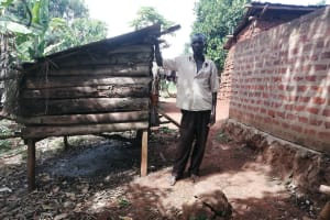 The Water Project: Kabo Village -  Man Stands With His Chicken Coop