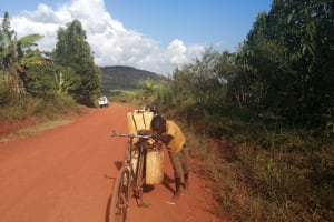 The Water Project: Kabo Village -  Pushing Bike With Water Containers