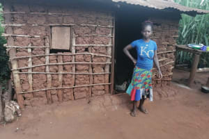 The Water Project: Kabo Village -  Standing Outside Kitchen Building