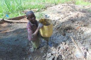 The Water Project: Bukhaywa Community, Ashikhanga Spring -  Helping To Mix Concrete