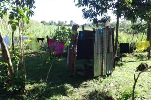 The Water Project: Mahira Community, Kusimba Spring -  Bathing Shelter And Clothesline