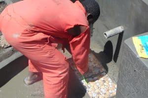 The Water Project: Bukhaywa Community, Ashikhanga Spring -  Tile Setting