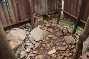 The Water Project: Harambee Community, Elijah Kwalanda Spring -  Bathing Shelter Rocky Floor