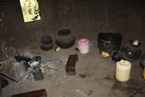 The Water Project: Litinye Community, Shivina Spring -  Stove And Water Storage In Kitchen