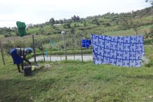 The Water Project: Mahira Community, Kusimba Spring -  Washing Clothes