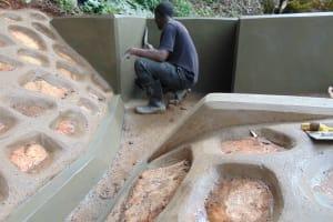 The Water Project: Chepnonochi Community, Shikati Spring -  Plastering