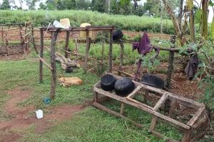 The Water Project: Harambee Community, Elijah Kwalanda Spring -  Dog Asleep Under A Dishrack