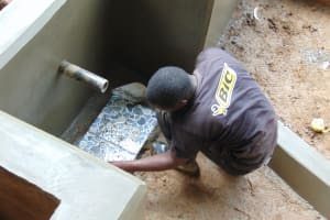 The Water Project: Chepnonochi Community, Shikati Spring -  Tile Setting