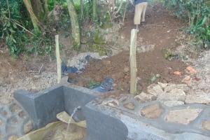 The Water Project: Bukhaywa Community, Ashikhanga Spring -  Backfilling With Soil