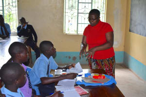 The Water Project: St. Peter's Khaunga Secondary School -  Trainer Jacky Reviewing Training Materials With Pupils