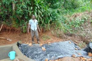 The Water Project: Chepnonochi Community, Shikati Spring -  Laying The Tarp