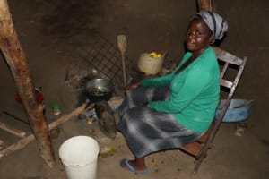 The Water Project: Mukhonje Community, Mausi Spring -  Grace Prepares Food In Her Kitchen