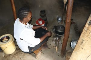 The Water Project: Mukhuyu Community, Chisombe Spring -  Community Member Cooking