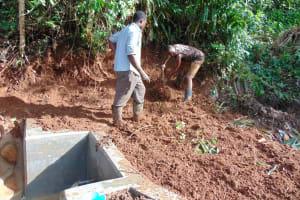 The Water Project: Chepnonochi Community, Shikati Spring -  Soil Backfilling