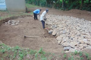 The Water Project: Friends Kuvasali Secondary School -  Laying Stones For Rain Tank Foundation