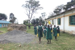 The Water Project: Friends School Mahira Primary -  Students Bring Water For Construction