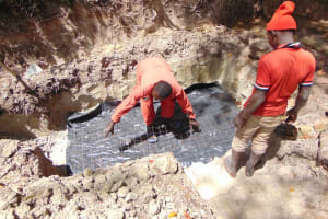 The Water Project: Bukhaywa Community, Ashikhanga Spring -  Laying The Foundation