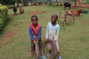 The Water Project: Harambee Community, Elijah Kwalanda Spring -  Children Playing With Used Tires