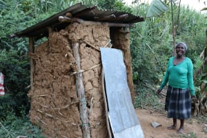 The Water Project: Mukhonje Community, Mausi Spring -  Grace Stands With Her Pit Latrine