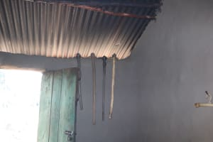 The Water Project: Mukhuyu Community, Chisombe Spring -  Farm Tools Placed In Corner Of House