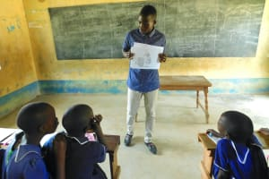 The Water Project: Makale Primary School -  Trainer Shows A Poster To Lead A Discussion
