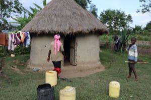 The Water Project: Mukhonje Community, Mausi Spring -  Water Storage Outside A Kitchen