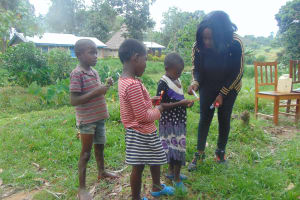 The Water Project: Bukhaywa Community, Ashikhanga Spring -  Georgina Hands Out Supplies In Dental Hygiene Session