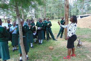 The Water Project: Friends Kuvasali Secondary School -  Facilitator Laura Takes Students Through Training
