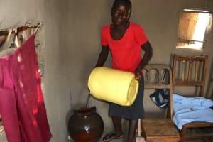 The Water Project: Mukhonje Community, Mausi Spring -  Filling Water Storage Pot