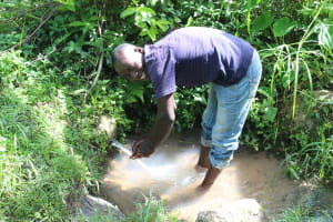 The Water Project: Litinye Community, Shivina Spring -  Mark Washing Hands At The Spring