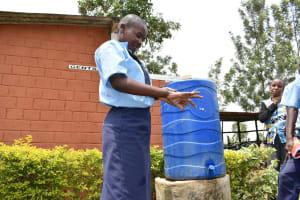The Water Project: St. Peter's Khaunga Secondary School -  Pupil Demonstrates Handwashing