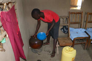 The Water Project: Mukhonje Community, Mausi Spring -  Drawing Water From Storage Pot