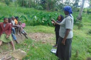 The Water Project: Bukhaywa Community, Ashikhanga Spring -  Georgina Teaches Handwashing Steps
