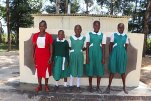 The Water Project: Friends School Mahira Primary -  The Ladies With Their Teacher At The Latrines