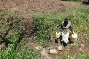 The Water Project: Mahira Community, Jairus Mwera Spring -  Community Member Arrives At The Spring