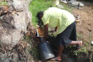 The Water Project: Mahira Community, Kusimba Spring -  Collecting Water