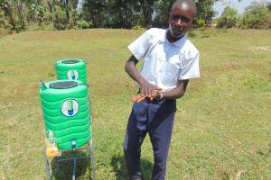 The Water Project: Friends Secondary School Shirugu -  Student Elvis Demonstrates Handwashing
